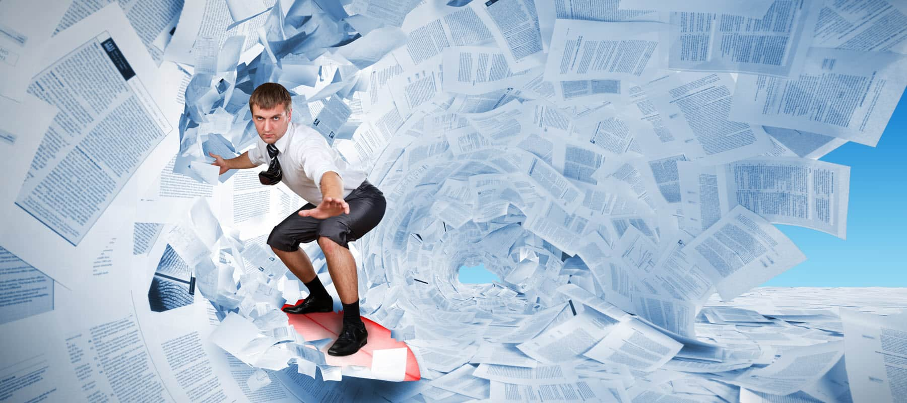 Man surfing on wave of paperwork